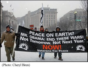 Veterans marching with banner for peace