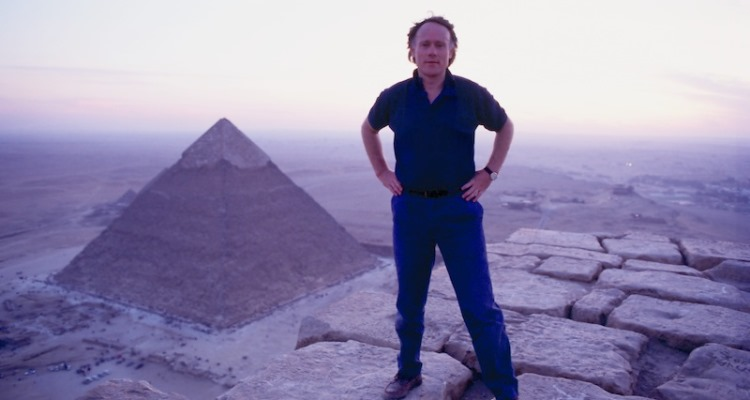 Graham Hancock on top of the Great Pyramid of Giza Photo by SANTHA FAIIA_Graham-Hancock_OMTimes