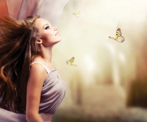 Fashion Art Beauty Portrait. Beautiful Girl in Fantasy Mystical and Magical Spring Garden. Model Wom